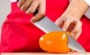 Image of a knife cutting a pepper.