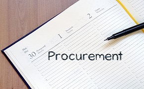 Pen and paper with the word procurement written on it.
