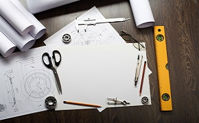 Plans and designs on a table.