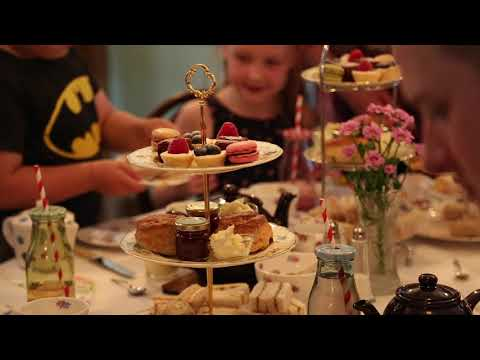 An afternoon tea with cakes on a stand.
