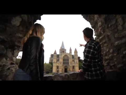 A man and a woman looking at Rochester Cathedral.