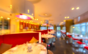 A blurred image of the inside of a restaurant.